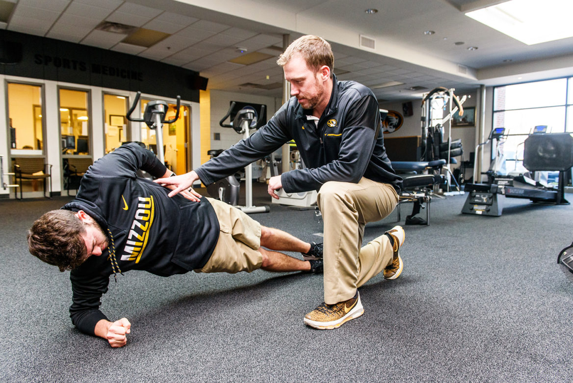 Physical Therapist Andrew Turpin works with Mizzou golfers.